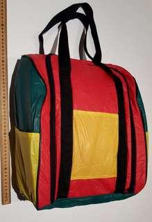 Multicolored padded bag with zip closure