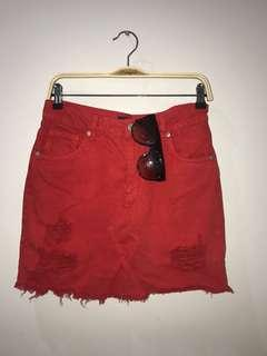 Red distressed denim skirt