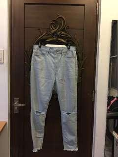 Uniqlo size 28 with styled ripped knees