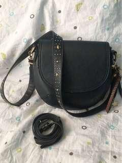 Call it spring bag with extra strap
