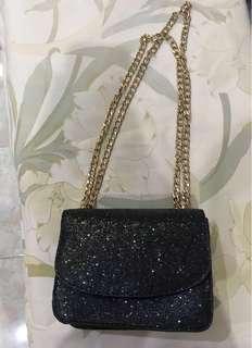 Gliter sling bag