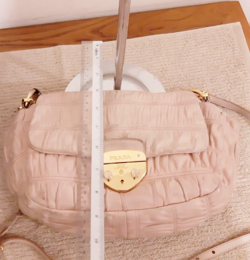 AUTHENTIC PRADA NAPPA GAUFRE LEATHER SHOULDER BAG - COMES WITH LONG CROSSBODY SLING STRAP - BABY PINK COLOUR- OVERALL FAIR / OK - CLEAN INTERIOR- (BOUGHT AT OVER RM 6500+) - RM 380 ONLY