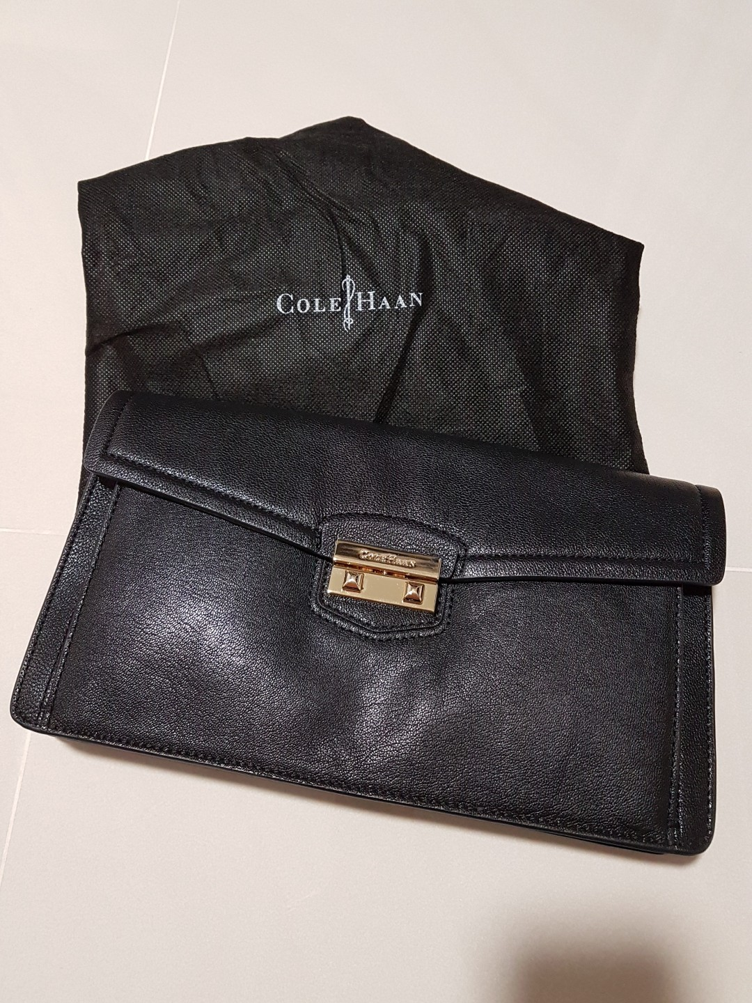 fb8097b908 Cole Haan leather clutch, Luxury, Bags & Wallets, Clutches on Carousell