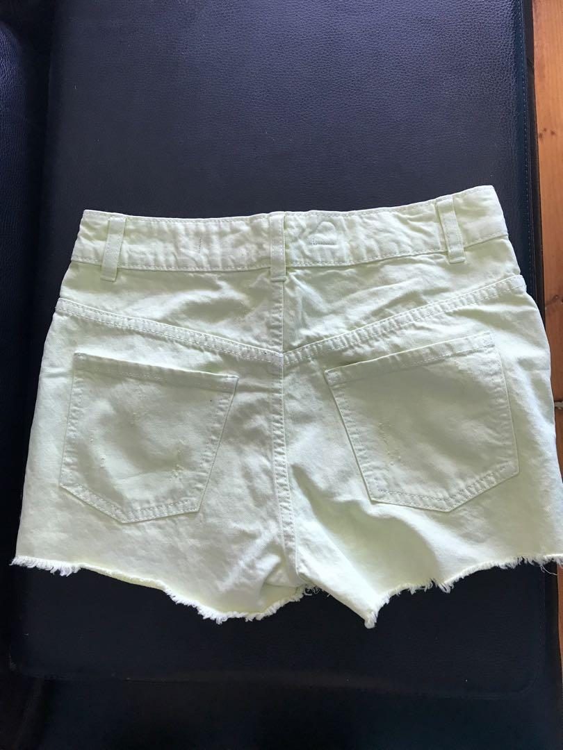 Lemon yellow high waisted ripped detail denim shorts 8