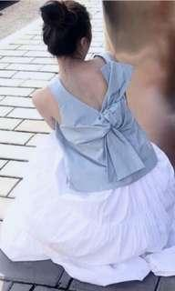 Two way spring blue asymmetrical bow top