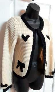 Knit blazer with black accents and bow detail