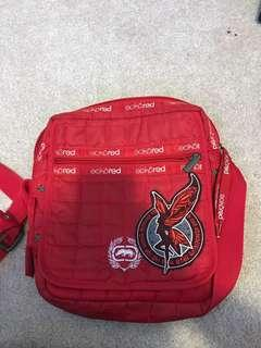 Eckō red shoulder bag.