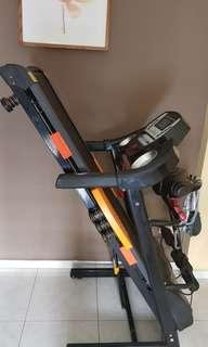 Treadmill with massager and dumbbell setup