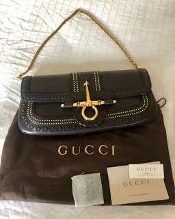 Rare Gucci clutch with gold chain
