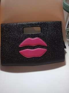 Women's large clutch- lip embellishment