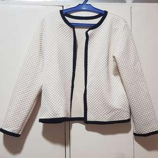 Quilted white cardigan with black lining