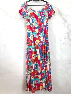 Long cotton dress in colourful fun outdoor lifestyle print