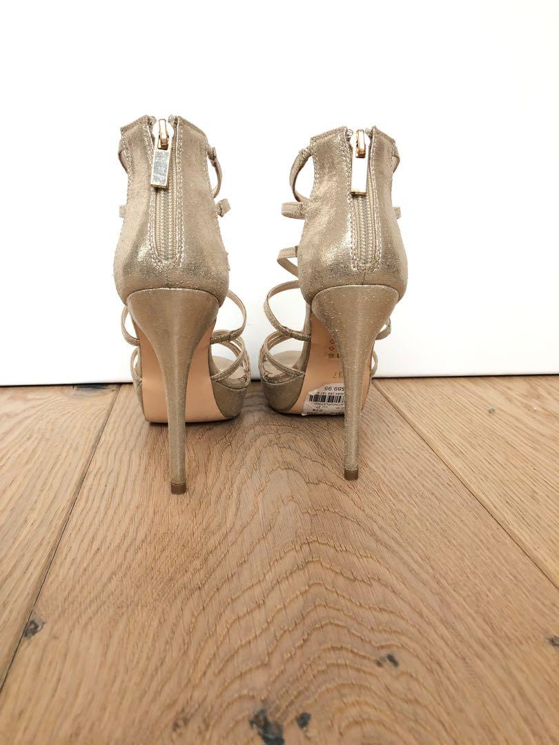 Le Chateau Platinum/gold metallic strappy high heels. Worn once. Size 7