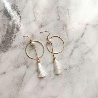 White circle tassel earrings