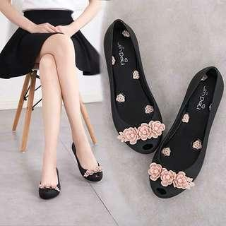 Jelly shoes with flower detail