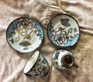 Ceramic miniature cup and saucers