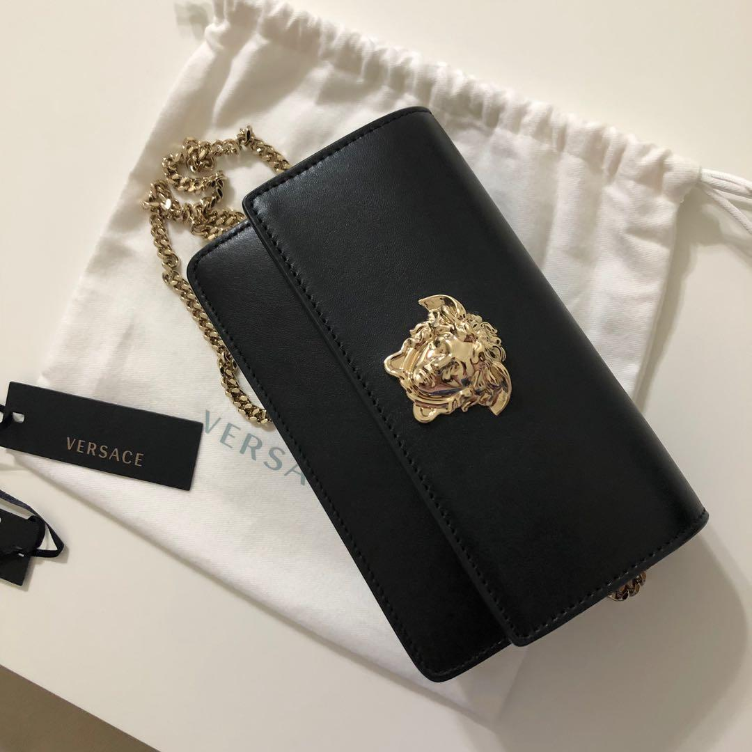 Versace sling clutches 💯 Authentic