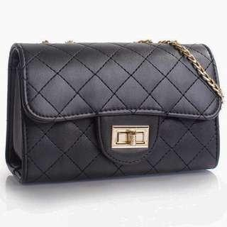 VOIR Quilted Sling Bag with front flap closure
