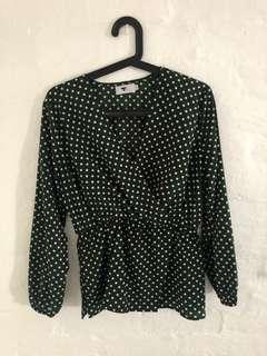 Green and white polka dot top