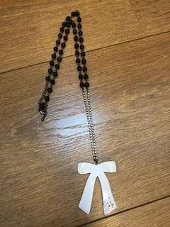 Ribbon and pearl long necklace