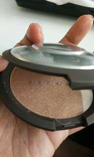 Becca highlighter shade topaz