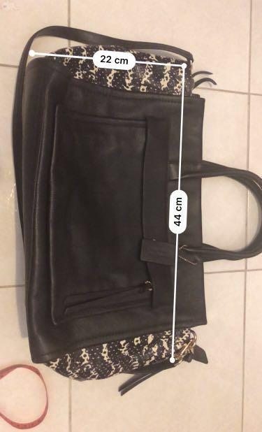 Authentic Coach leather 2 way bag. Used only once . Excellent condition like new . No defect . With dustbag and authentic card.