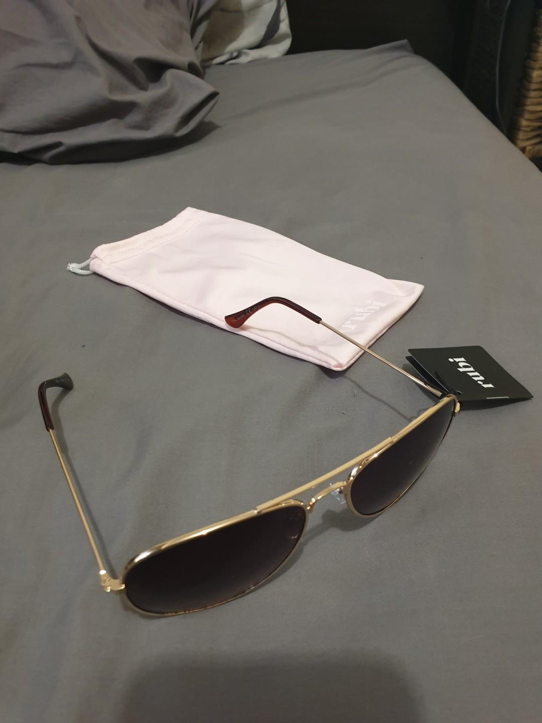 Gold rubi aviator sunglasses, never worn, comes with a protective case