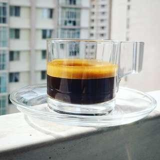 Clear glass espresso cup and saucer set