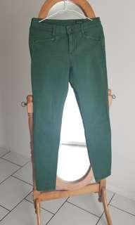 Stretchy green jeans by Club Monaco