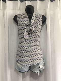 Flowy zigzag pattern top with neck tie detail.