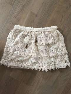 Size 8 crochet cream skirt with tie. Excellent condition
