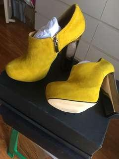 Nicholas yellow ankle boots
