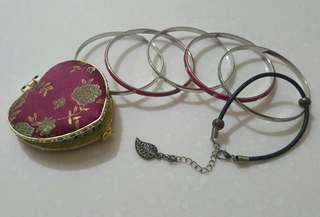 Bracelets and Clasped Mirror