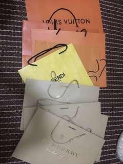 Assorted paper bags Louis Vuitton, Fendi & Burberry
