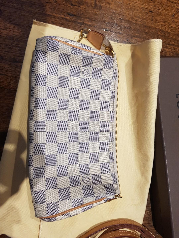 Louis Vuitton authentic with Receipt eva clutch denier azur