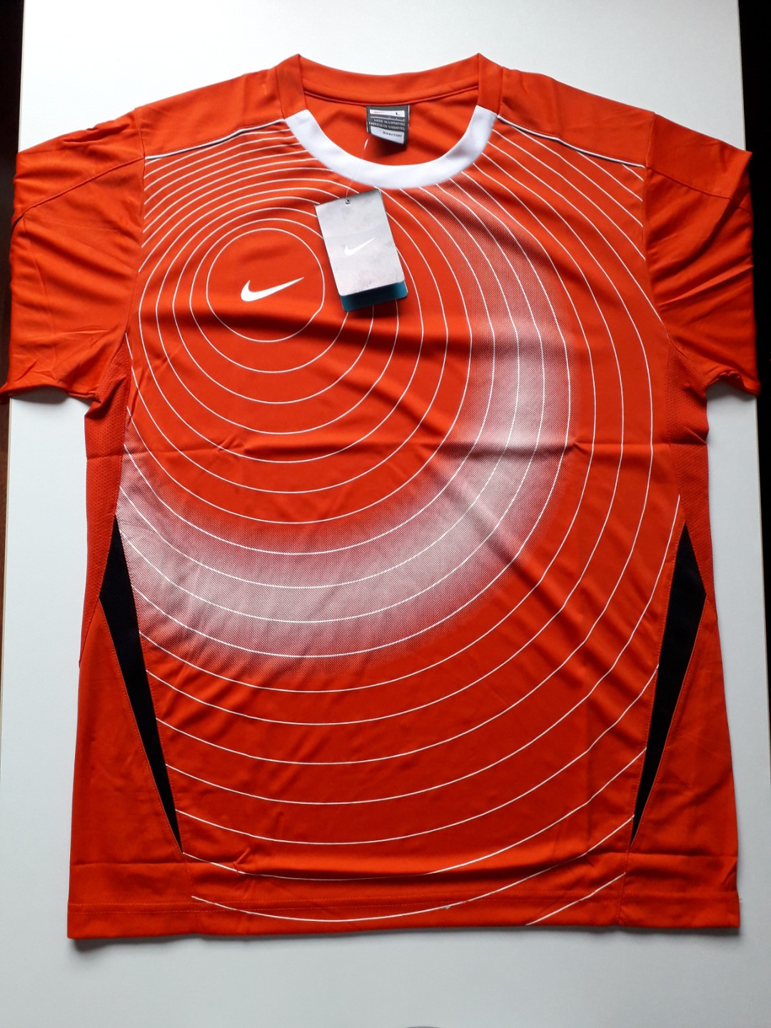 7a47dfb5f Nike Graphic Dry Fit T Shirt ORANGE, Sports, Sports Apparel on Carousell