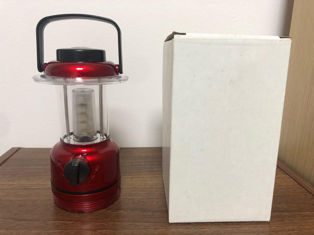Portable lamp with compass