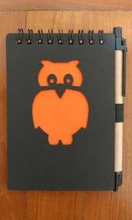 Owl small notebook with lines and black ballpoint pen