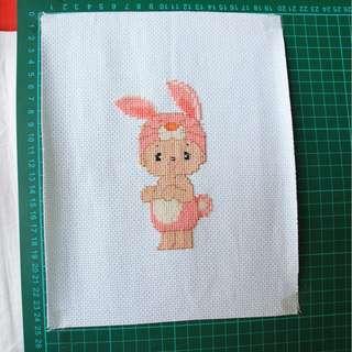 Kristik Bayi dengan Kostum Kelinci