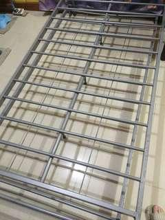 Bed frame with pull out bed