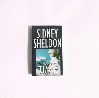 Sidney Sheldon: The Sands of Time • Pre-order