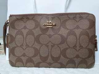 Reduce Authentic Coach double large wristlet