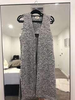 Sleeve less grey and black coat