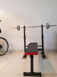 Barbell with plates and bench