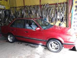 Jual bu ford laser ghia thn 88 bpkb only pajak off