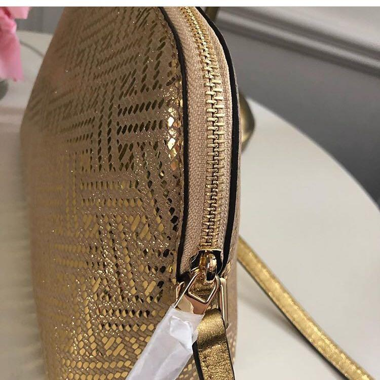 Micheal Kors Adele Crossbody in Pale Gold