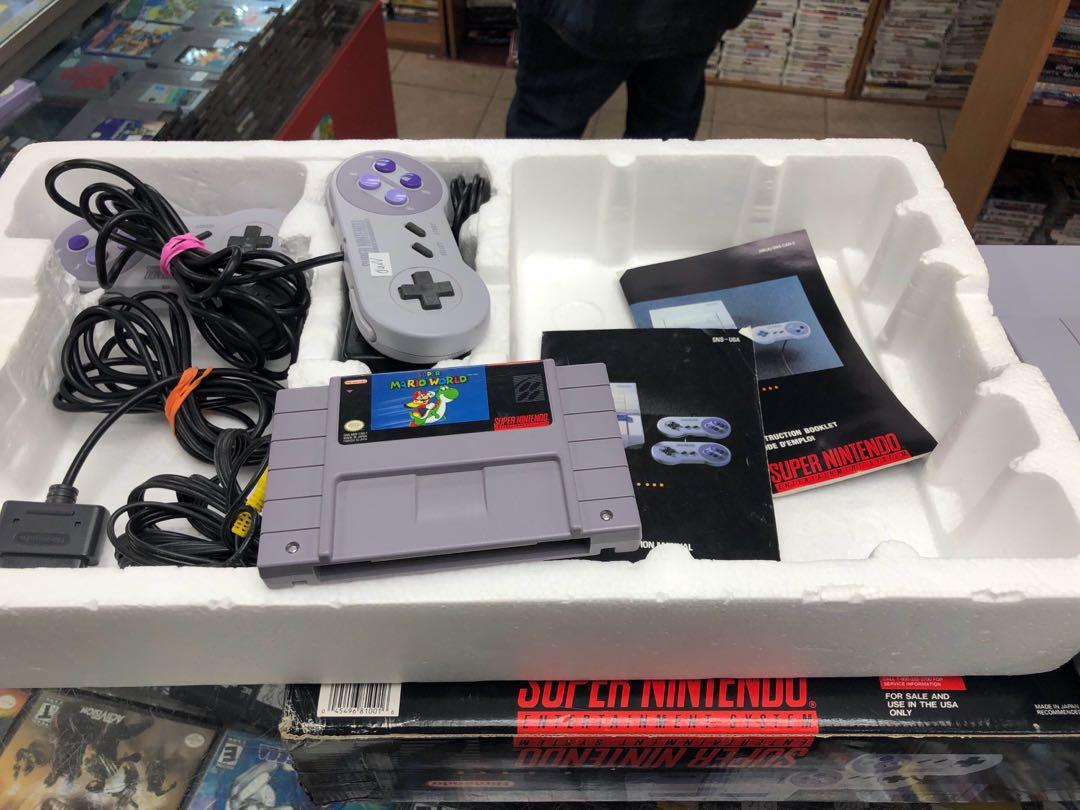 Vintage game console Super Nintendo in box with game and two controllers
