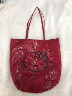 Red faux snake skin bag