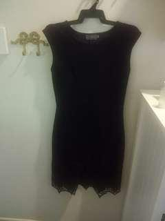 Tight black dress with detailed hemline size M