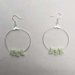 Fine silver hoop earrings with green butterfly beads